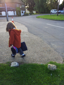 back of little girl going to school